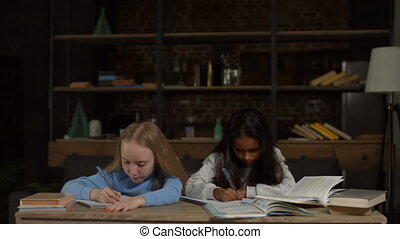 Clever girls doing homework for elementary school
