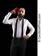 Clever hispanic young man with a red smartphone having an idea