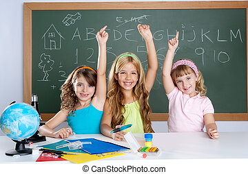 clever kids student group at school classroom raising hand...