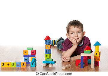 Clever little boy with toys
