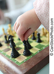 Clever little girl playing chess