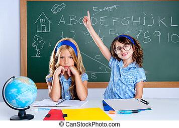 clever nerd student girl in classroom raising hand