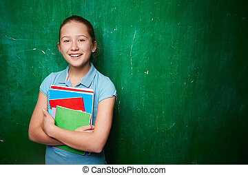 Clever schoolgirl - Portrait of cute schoolgirl with ...