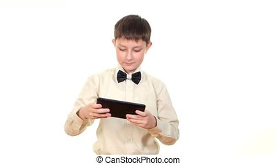 Clever, smart school boy playing using tablet computer, on white background