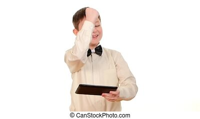 Clever, smart school boy playing using tablet computer, on white background, slow motion