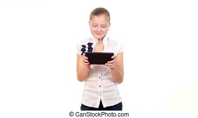 Clever, smart school girl playing using tablet computer, on white background