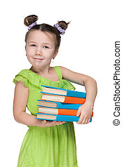Clever smiling little girl with books