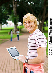 clever student - clever uni student using laptop in park