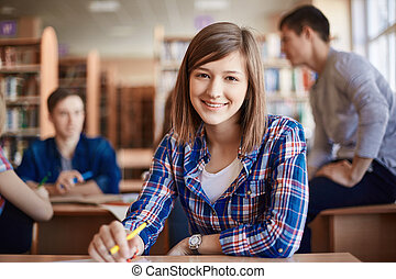 Clever teenager - Happy teenage girl looking at camera by...