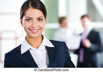 Clever woman - Portrait of clever businesswoman looking at ...