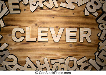 CLEVER word made with block letters lying on wooden board