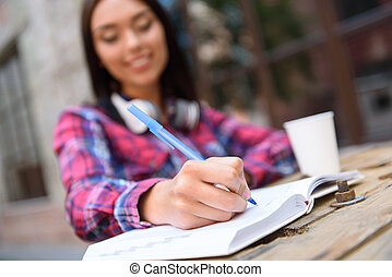 Clever young girl doing homework