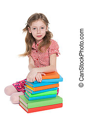Clever young girl near books