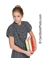 Clever young girl with books