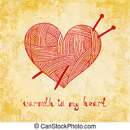 clew heart with knitting needle on grunge background