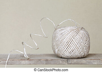 Clew of linen twine on a wooden shelf