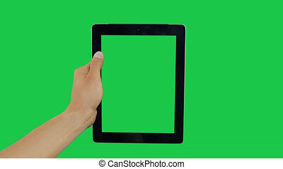 Pointing Finger Clicking On Center Device Screen with Green Background. Digital Tablet Green Screen. Use in any project that depicts finger, gesture, touchscreen and the like.