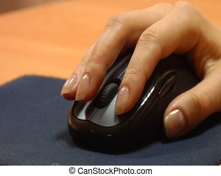 Click - Woman hand on a mouse