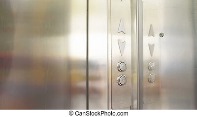 Clicking on the button in an elevator and lift movement -...