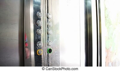 Clicking On The Button In An Elevator And Lift - People...