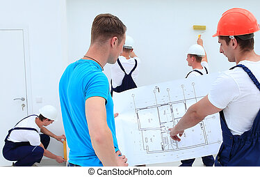 client and architect discussing construction project -...