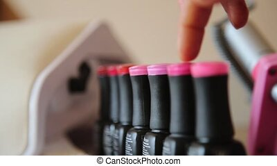 client chooses nail polish before painting nails. Manicure nail care in a beauty salon