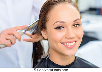 Client enjoys combing procedure.
