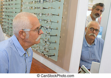 client fitting the eyeglasses