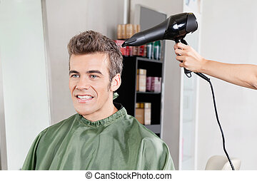 Client Gets His Hair Dried In Salon