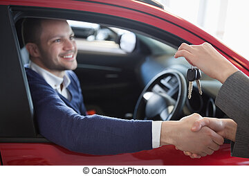 Client shaking hand to a woman