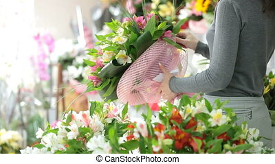 A man buying bunch of flowers in florist shop