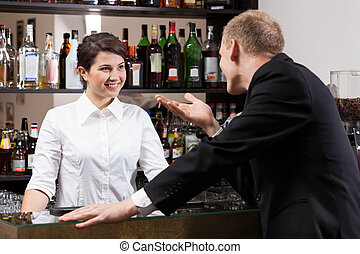 Client talking with girl bar
