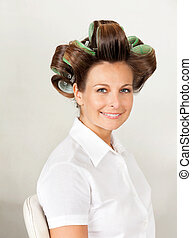 Client With Hair Curlers In Salon