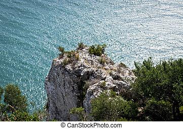 Cliff above the sea in Puglia Italy