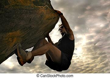 Cliff Climber - Rock climber reaching for the sky.