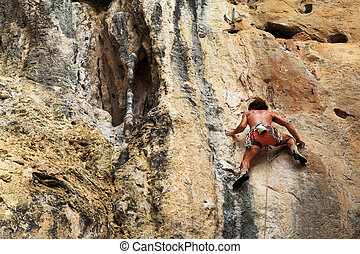 Cliff Climber - Young man climbing at the cliff