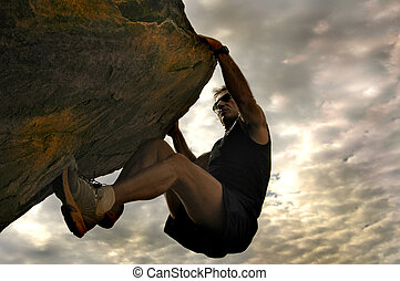 Rock climber reaching for the sky.