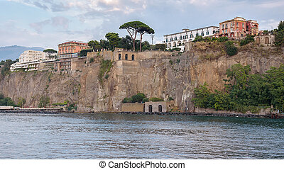 Cliff coast in Sorrento town at dusk