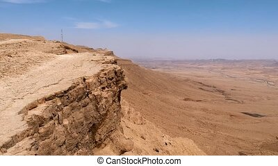 Cliff edge at Makhtesh Ramon crater - Drone aerial view of...