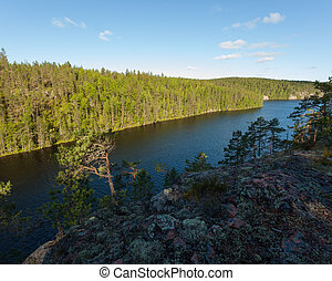 Cliff forest lake landscape in Finland