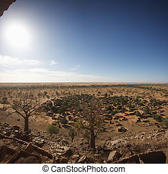 The Bandiagara site is an outstanding landscape of cliffs and sandy plateaux with some beautiful Dogon architecture