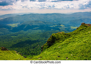 cliff over the hill in high mountains. beautiful summer...