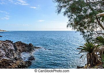 Cliff With A Privileged View Of The Infinite Ocean At Sunset Playa De Las Americas. April 11, 2019. Santa Cruz De Tenerife Spain Africa. Travel Tourism Street Photography.