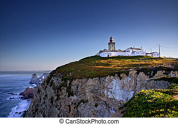 Cliffs and lighthouse - Dramatic view of cliffs and ...