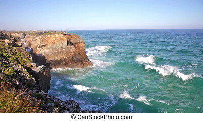 Cliffs and sea in Ribadeo, Spain - Ocean waves rolling on...