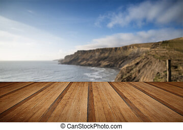 Cliffs landscape stretching out to sea with wooden planks floor