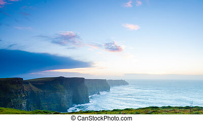 Cliffs of Moher at sunset in Co. Clare Ireland Europe. -...
