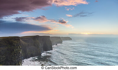 Cliffs of Moher at sunset in Co. Clare Ireland - Famous...