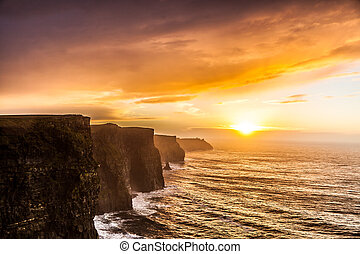 Cliffs of Moher at sunset in Co. Clare, Ireland Europe -...