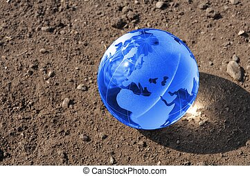 climate change concept with earth planet on dry soil and ...